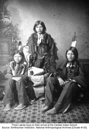 Three Lakota boys on their arrival at the Carlisle Indian School. Source: Smithsonian Institution, National Anthropological Archives [Choate #125].